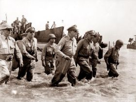 United States GI's led by General Douglas MacArthur in their first promised return in 1944