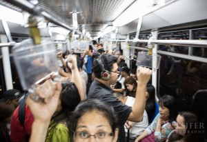 Queson City, Philippines - A lightly loaded rail car is about to get so crammed I can't even lift the camera over my head in metro Manila's MRT transit system.