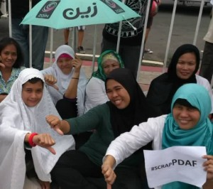 Photo of our Muslim sisters were taken during the #MillionPeopleMarch. Shukran Jazilan! Moving forward beyond ideology, political affiliation and religion!