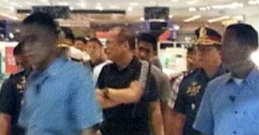Media mileage: Philippine President BS Aquino at the scene of a minor crime in SM North Mall