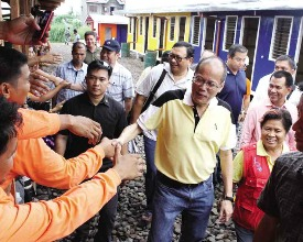 President BS Aquino takes time out for a photo-op while inspecting the controversial bunkhouses