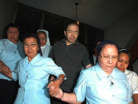 Striking a heroic stance: Jun Lozada surrounded by attack nuns