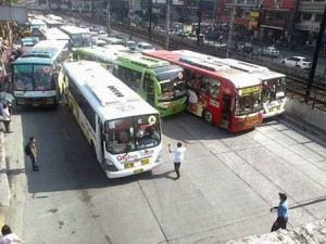 Lack of a modern system: Buses clamber all over one another to pick up passengers because of drivers paid on commission via the 'bounday' system.