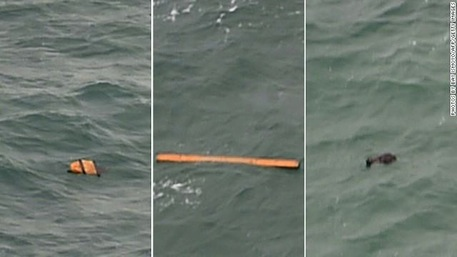Debris spotted by search crews earlier confirmed to be parts of QZ8501(Source: Photo posted by @CNN on Twitter.)
