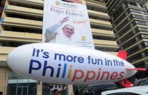 Commercialism and sloganeering has contaminated the papal visit in the Philippines.(Photo courtesy Manny Prieto)