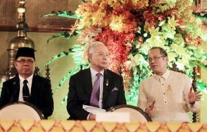 President BS Aquino, Malaysian Prime Minister Najib Razak, and Moro Islamic Liberation Front chairman Murad Ebrahim in happier times