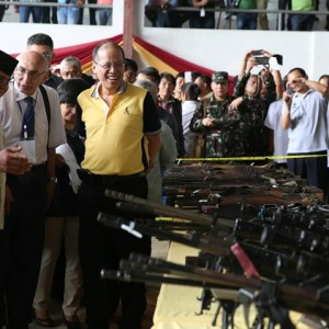 PR stunt: Ceremonial 'decommissioning' of weapons used to terrorise Mindanao for many years. (Courtesy Interaksyon.)