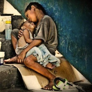 Unmoved by poverty in their own backyard: Filipinos have become desensitized to sights like these.