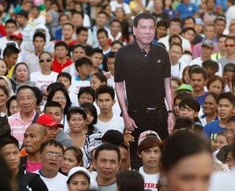"What if Duterte said, ""let's stop killing people..."" would his fans hold his cutout like that anymore?"