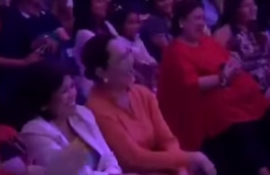 A member of the audience laughs heartily at Vice Ganda's objectionable jokes.