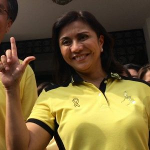VP candidate Leni Robredo flashes the 'Laban' sign while wearing a Yellow shirt.