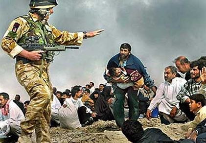 Photo of a British soldier towering over Iraqi civilians.