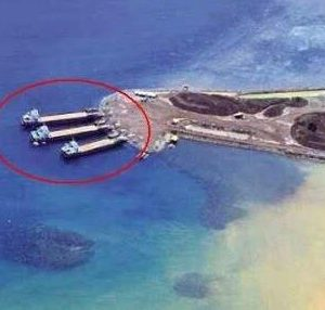 Ships seemingly being loaded with soil to be shipped to Chinese land reclamation operations in the South China Sea (Source: The Maharlikan)